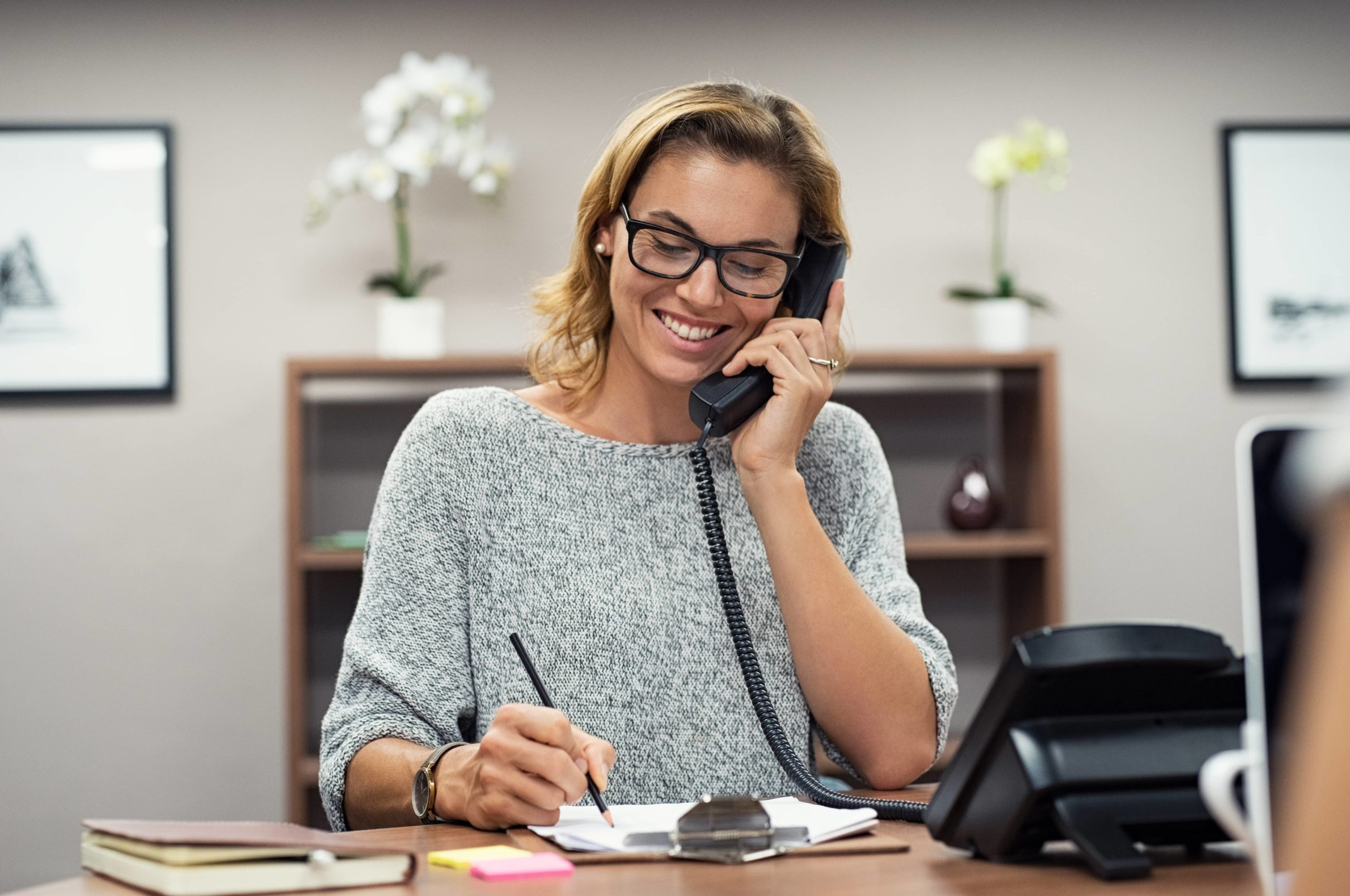 woman accepting call for propane tank delivery